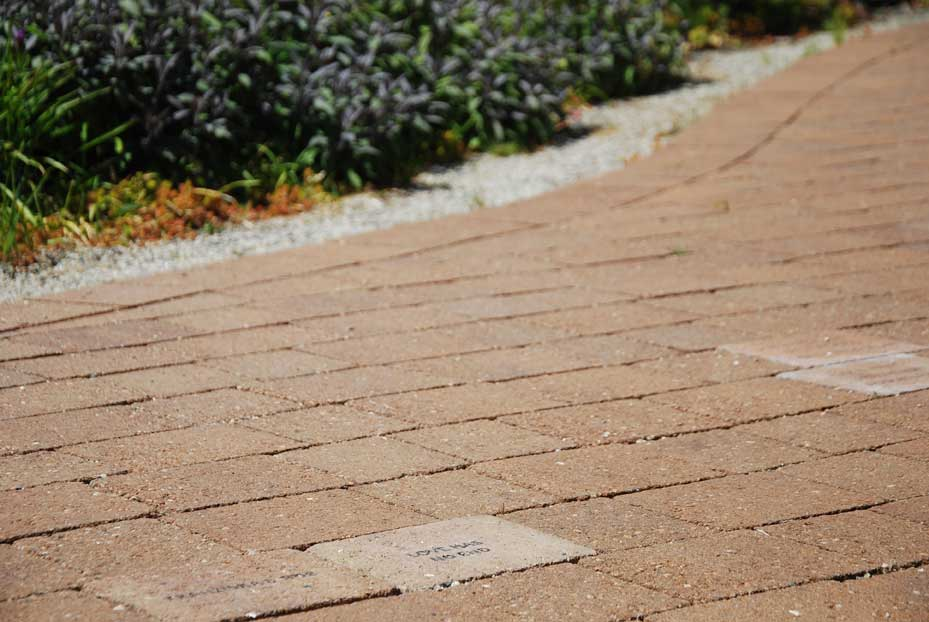 Close up of inscribed pavers on terrace
